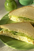 Egg Salad Sandwich with Lettuce on White Bread; Halved