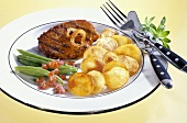 Grilled loin steak with fried potatoes and beans