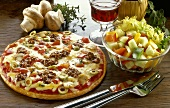 Pizza with vegetables, olives and mince