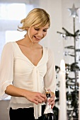 Young woman opening champagne bottles