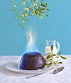 Flaming Christmas pudding and mistletoe
