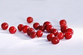 Fresh cranberries on light background