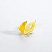Squeezed lemon wedge