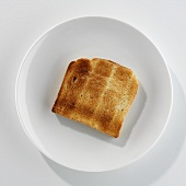 A slice of toast on a plate
