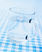 A glass mug of mineral water
