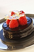 Small chocolate cake with raspberries