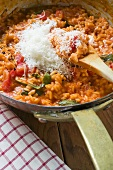 Tomato risotto with basil and grated cheese