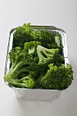 Steamed broccoli in an aluminium container