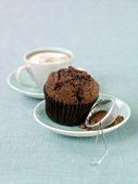 Chocolate muffin and cappuccino
