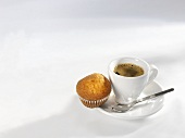 An espresso with a mini-muffin