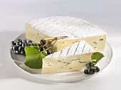 Blue cheese with black grapes
