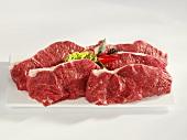 Five raw sirloin steaks