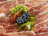 Grapes on sliced Parma ham