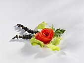 Tomato rose with lettuce leaf and bunches of pepper