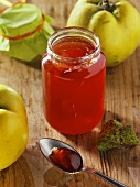 Quince jelly in a jar and on a spoon