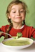 Girl eating vegetable soup