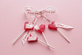 Four heart-shaped lollipops with bow