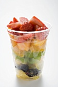 Fruit salad in a plastic cup
