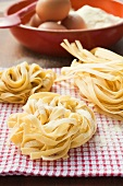 Three ribbon pasta nests