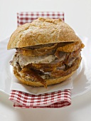 Sliced roast pork in a roll