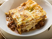 A portion of lasagne in a deep plate