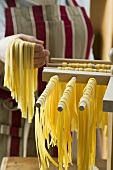 Hanging up ribbon pasta to dry