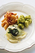 Three pasta dishes on one plate