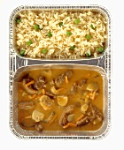 Strips of beef in wine sauce with mushrooms and rice