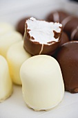 Mini-Dickmanns (chocolate covered marshmallows), one with a bite taken