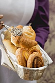 Croissants and Danish pastries in a small basket