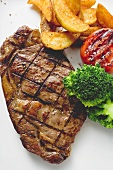 Grilled rump steak with country potatoes and vegetables