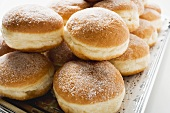 Fresh doughnuts on a silver platter