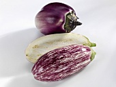 Whole and halved aubergines