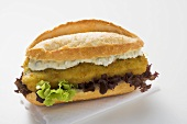 Fish burger with lettuce and remoulade