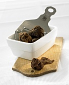 Truffles and truffle slicer in a small dish