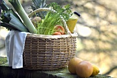 Fresh fruit, vegetables and juice in shopping basket