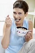 Woman eating muesli