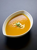 Carrot soup in a small bowl