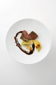 Roasted venison medallion with fennel and ravioli