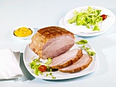 Cooked ham with mustard and salad