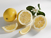 Whole and halved lemons with lemon wedges
