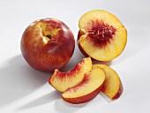 Whole and half nectarine and nectarine slices