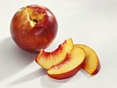 Whole nectarine and nectarine slices