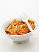 Ravioli in tomato sauce in a small bowl