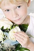 Boy with bouquet of white roses