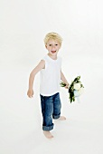 Cheerful boy with bouquet of white roses