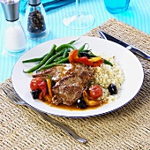 Pork neck steak with couscous and roasted vegetables