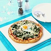 Spinach pizza with fried egg
