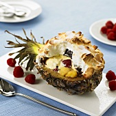 Vanilla ice cream & fruit under baked meringue in pineapple