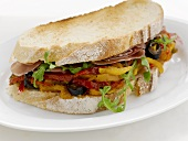 Pepper, olive and Parma ham sandwich